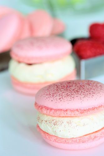 raspberry macarons with white chocolate cream - there's a recipe for Black Forest macaroons in this blog :-)