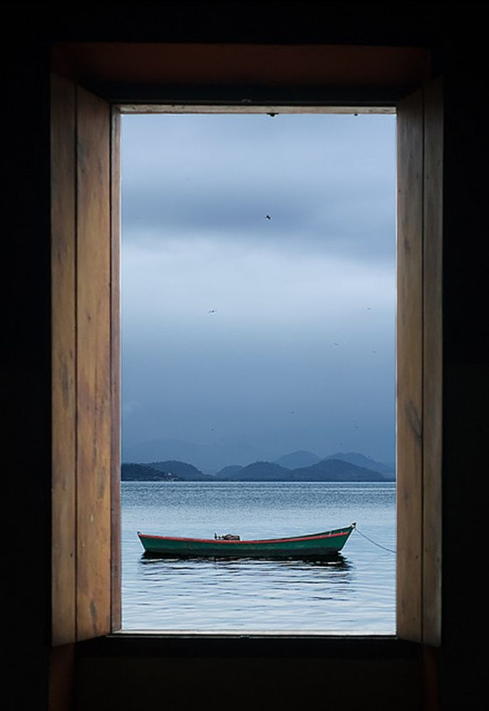 "Window scene from the ""Casa de Artes"" in Paquetá Island - Guanabara Bay, Rio de Janeiro. In the distance are the hills of São Gonçalo."
