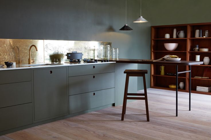 Aged brass splashback. Cabinets and walls in Little Greene's Invisible Green    Naked Kitchens