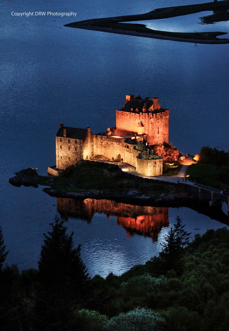 Eilean Donan Castle, Scotland, at night.   - Explore the World, one Country at a Time. http://TravelNerdNici.com