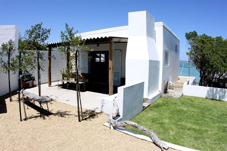 Baby Blue Cottage - Baby Blue is a compact studio cottage equipped with everything a couple or small family needs for a seaside break. Situated above Sandbaai in Langebaan, guests have direct beach access and unimpeded views.The ... #weekendgetaways #langebaan #westcoast #southafrica