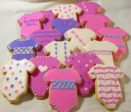 Onesie Cookie Design ideas! I use a different cookie and frosting recipe - but I'm sure this is good too.  Another tip...only decorate 6-7 cookies at a time so that they don't harden before you're finished!
