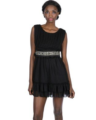 Sophistication meets ultimate style with this sleekBelted Dress by Cutie. This elegant mini dress features a sleeveless, bust covered in pintucks. A double-tiered ruffle at the hemline and a cinched waist complete with a bejewelled belt will give you a fabulous, hourglass shape. The fabric\'s polyester and viscose ensure a comfortable fit. Complete your cutesy look with a pair of platform heels and bold jewellery for a fun night out.