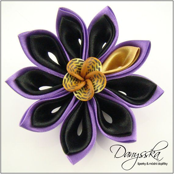 This flower is made of satin.    It has approximately 7 cm (2.75 inches) in diameter.    In the centre there is a pink flower cabochon made of polymer clay. It has approximately 2 cm (0.78 inches) in diameter.    At the back of the flower there is a multifunctional component which can be used as a brooch or hair clip.    Specification:    - color: black, gold, purple  - diameter of the flower: 7 cm (2.75 inches)  - material: satin, polymer clay cabochon  - material of components: base metal…