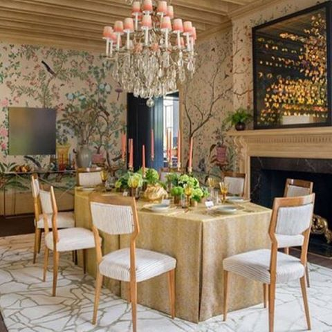 Vintage chairs surround the beautiful tabletop, a large crystal chandelier with ombred pink shades. The Chinoiserie wallpaper adds classic proportions, while the 3d butterflies pop above the fireplace creating an eclectic mix of old & new.  #LiveStylishly