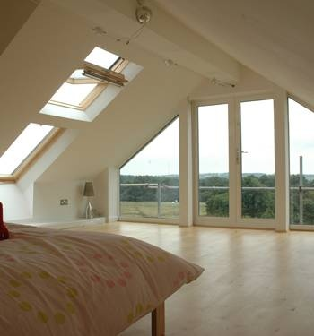 Master bedroom with a great view. Love tgis but want exposed ceiling beams and dark harwood too.