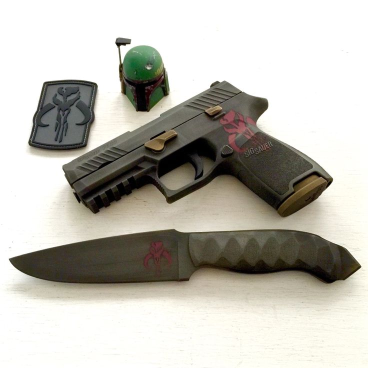 My new custom Sig P320 in Mandalorian/Boba Fett theme Cerakote finish. Winkler knife to match. Pictured with Black Series Boba Fett figurine, sideshow 1/6 scale helmet, and patches. Stay tuned to...