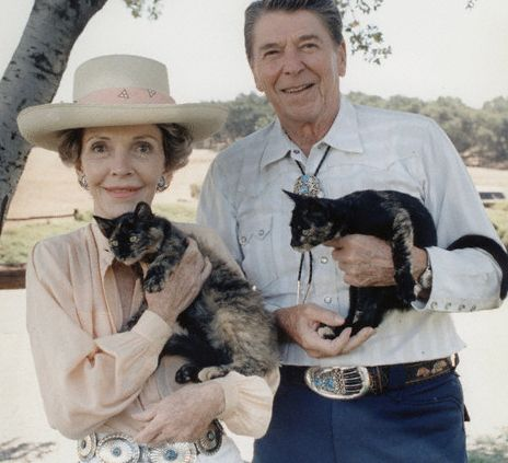 Nancy and Ronald Reagan with two cats at their ranch.
