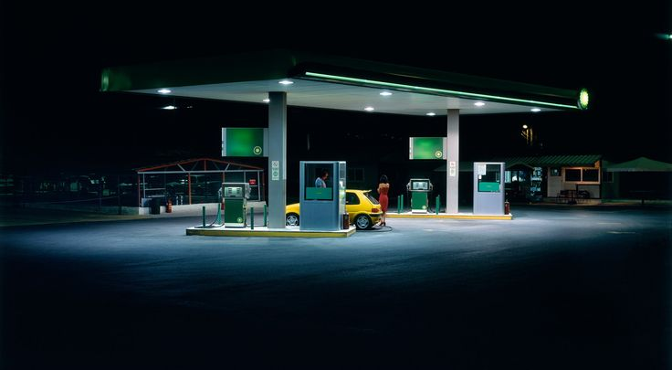 Panos Kokkinias - gas_station  I seem to be liking photos with some minor activity in them recently.
