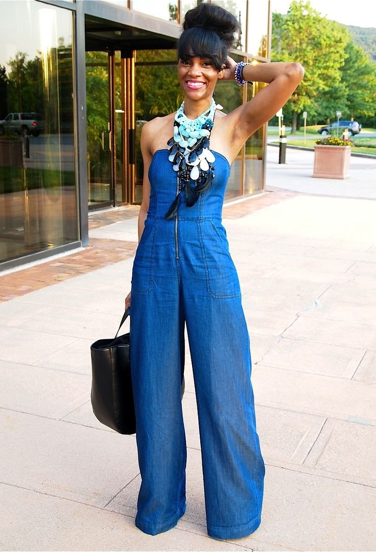 Lovely summer outfit - denim blue flared jumpsuit with stackable necklaces and black leather bag oh and the hairdo looks great #bluejumpsuit