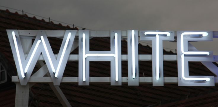 Neon sign manufactured by PRETENDE. Made for beach bar in Sopot, Poland. White neon light with illumination. Creative and catchy