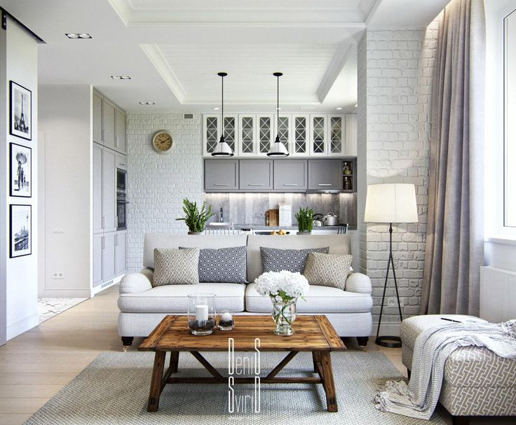 This small apartment has some great design features- brick walls, a white  palette,