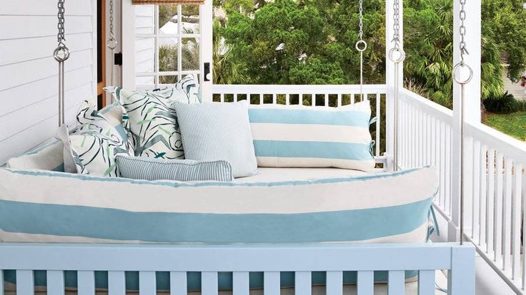 """""""One of my fondest memories is of sleeping on a hanging bed at my grandparents' fishing camp in Louisiana,"""" says the owner of this Cedar Key, Florida, beach house. """"I wanted to re-create that here."""" She and designer Melissa Rosenberg had a Houston craftsm"""