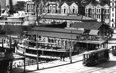 Circular Quay scene of 1902. American passenger liner Sierra at rear.The ferry Courier (1887-1930) in the foreground. Note the Tarpean Way wool stores and the Burns Philp & Company sign. •City of Sydney Archives•