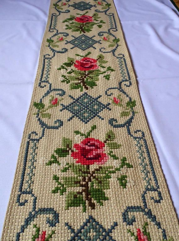 Lovely vintage handmade tapestry / table runner with Roses. Amazing handicraft cross stitch on linen canvas there is a lining at the back very precise work In an excellent vintage condition fringes in 3 colors Approximate measurements: 15 x 62,2 (38 cm x 158 cm) - with fringe the length is 173 cm (68,1) .............♥Please convo me if you have any questions♥.............. we can combine shipping, we ship worldwide