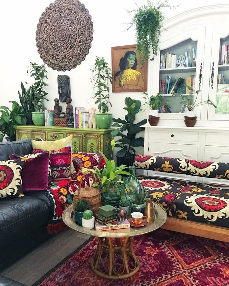 Sexy 1950's daybeds covered in suzani fabric. . Moroccan tray tables holding all the affirmation pretties. Turkish kilim cushions, mixed with English flocked velvet & Uzbekistan Suzanis. Vintage African art sculptures. An antique hand painted Indian cabinet. Our Goddess Gaia Moroccan boujaad rug hugging the floors