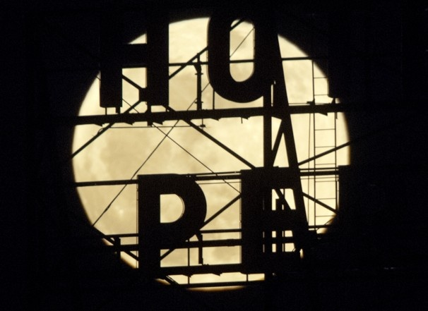 The supermoon appears above the temporarily closed Hotel Pere Marquette in Peoria, Ill.