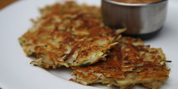 Traditional potato latkes are amazing as is, but if you're looking to try a healthier twist, pick up a zucchini at the store and try this. Adding zucchini not only adds a fun green hue, but it also lowers the carbs and calories.        Keep reading to.