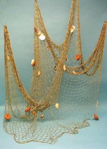 Intended for decorative purposes this is a great piece of fishnet, lightbrown in color and features authentic shells and cork floats tied to it. Give your den, game room, swimming pool or stair rails a nautical look. Also ideal for set decorating. Each piece measures approximately 4' x 9'. Price is for one piece.