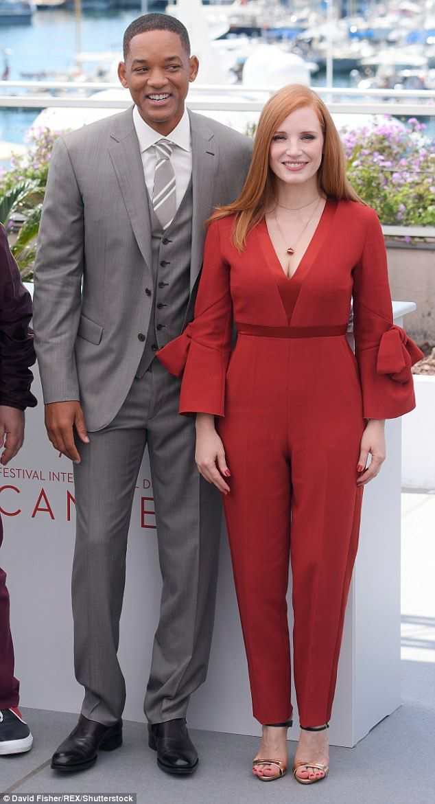 Me and Mr Smith: Her strapped heels were black and gold, and showed off her red pedicure [pictured with Will Smith]
