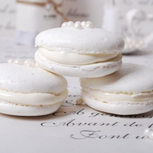 Lovely white french macaroons with edible pearls on top! Lovely and perfect for wedding guests.