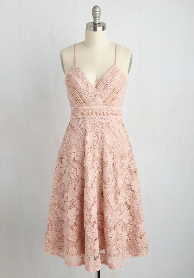 Resort culture is expected - sparkling mimosas, light conversation - but you shake up style precedents with this pastel pink dress. Though the midi length of this elegant A-line is a staple on the scene, its ornate crocheted lace overlay and twirl-worthy skirt usher an epoch of eye-catching aesthetics!