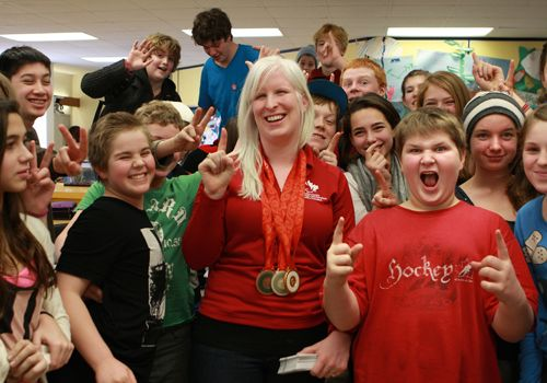 Chelsey Gotell with students at a school presentation