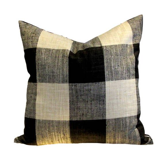 From the Kravet Rustic Cottage Collection, oversize Buffalo check (9 repeat) in black, charcoal and cream. Reverse is sewn in dark charcoal linen 100% polyester SEWN BY US IN CANADA PILLOW COVER ONLY with zippered closure All interior seams are reinforced and sewn corners are tapered to avoid dog ears dry cleaning recommended With large patterns, pattern placement will vary. Please let us know when you order should you have particular pattern placement requirements. Order filler separate...