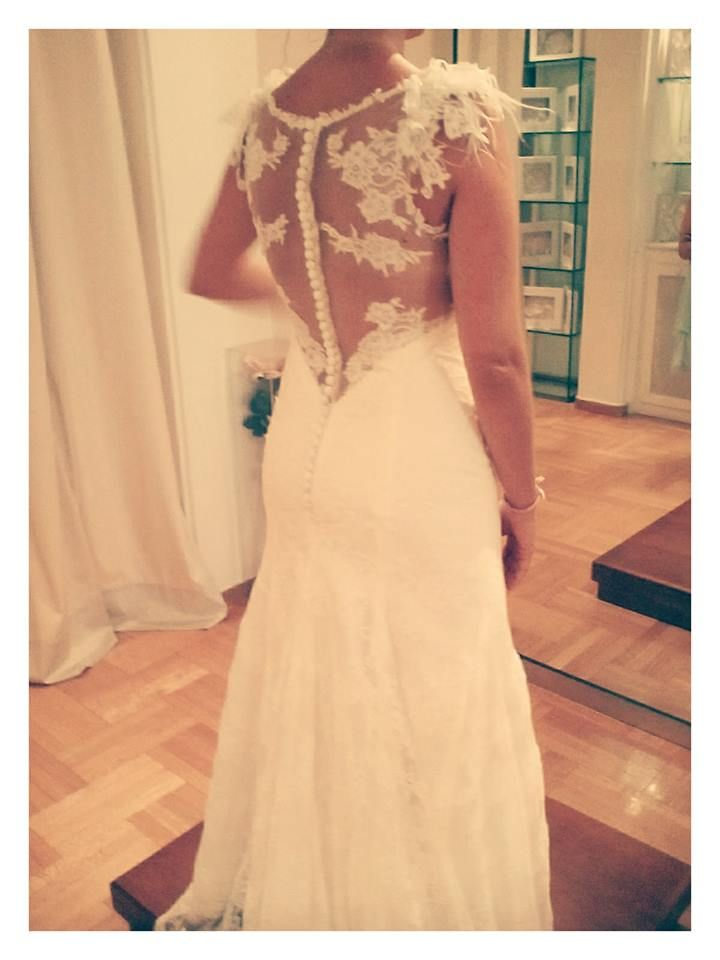 Eleni Kollarou / Lace wedding dress with a sheer back.