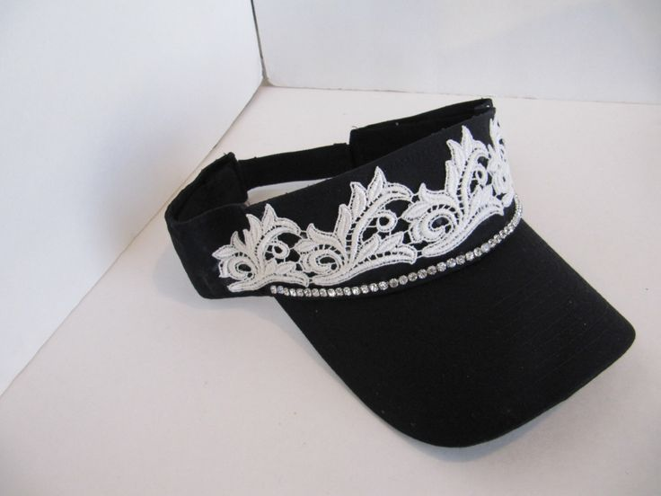 A personal favorite from my Etsy shop https://www.etsy.com/listing/260990852/black-sun-visor-womens-visor-bling-visor