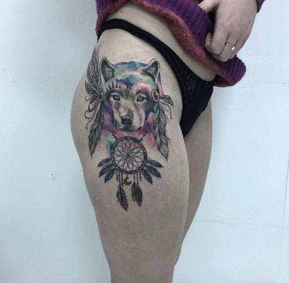 Feathered dreamcatcher wolf tattoo by Yula Yulasha