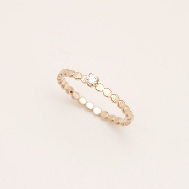 Diamond ring with hammered gold bead band, engagement ring, solitaire ring by ClaraChoJewelry on Etsy https://www.etsy.com/listing/164614636/diamond-ring-with-hammered-gold-bead