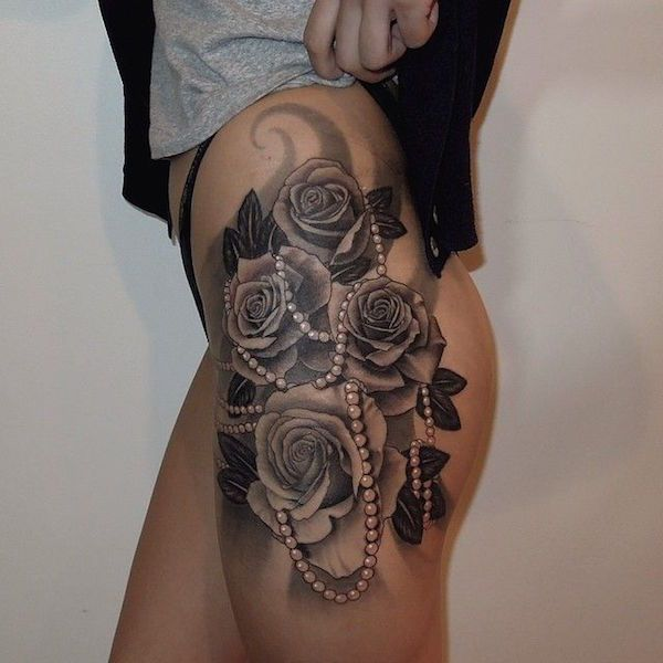 Feminine thigh tattoo - The flowers and pearls make me think this tattoo is feminine and at the same time beautiful. #TattooModels #tattoo