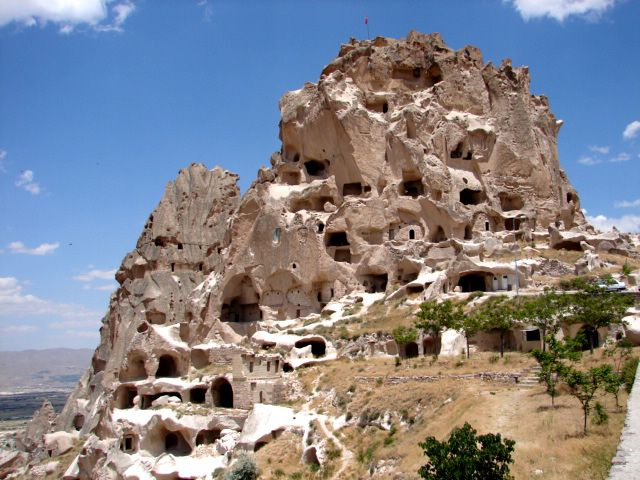 The natural rock formation that is Uchisar Castle is set above Goreme overlooking the fair chimneys and cone shaped rock formations of Cappadocia. The castle is the highest point in all of Cappadocia.