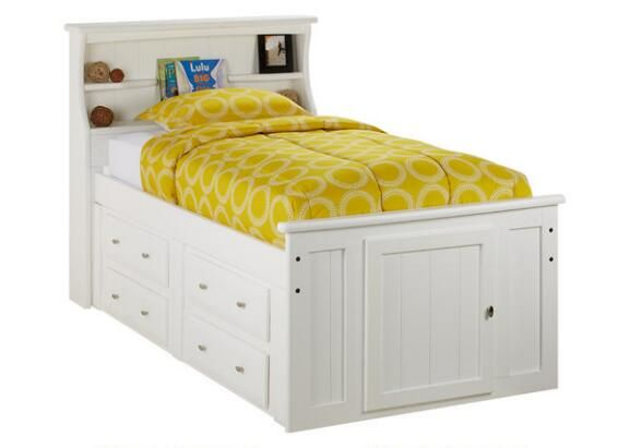 Our Catalina Twin Roomsaver Bed expands your child's bedroom with a space-conscious contemporary styled captain's bed with storage. The piece comes in a white paint finish and features a headboard with shelving space for books, alarm clock, nightlight and framed photos. In addition, the four drawers located underneath the bed are perfect for keeping spare blankets, pillows and sweatshirts. Functional and fashionable, this bed is sure to be a space-saver.