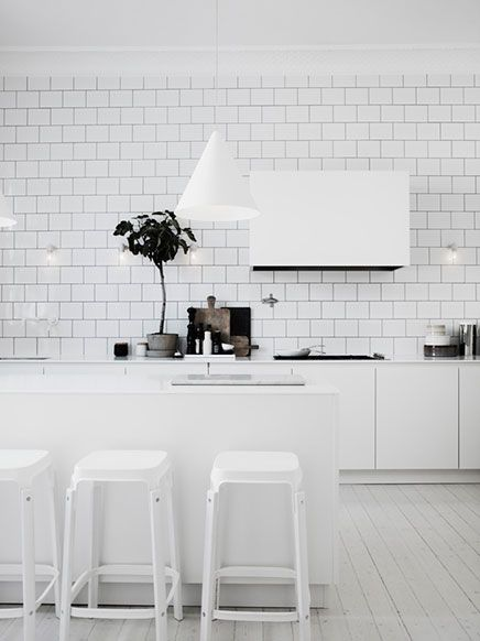The White Kitchen - And the Black background of the White Tiles brings everything together