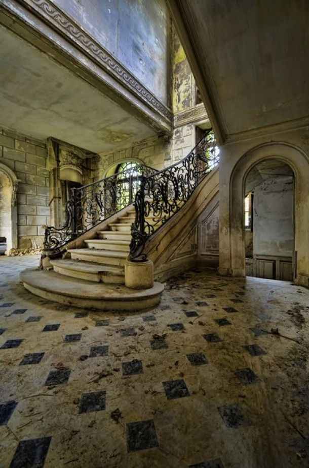 Look at the craftsmanship of the stairs and floor. Someone put such great love and money into this now sad shadow of a grand home.