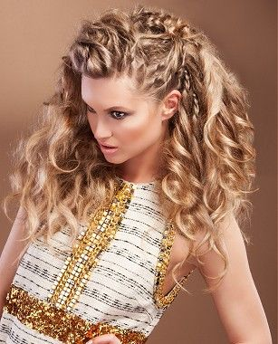 A long blonde curly coloured hairstyle by Karine Jackson