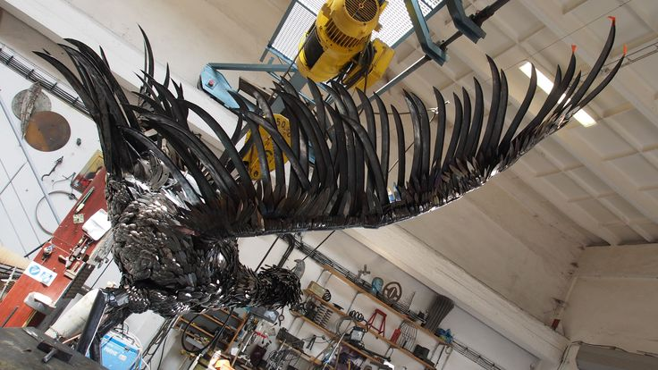 Steel sculpture of a bladed ripper bird made from spoons,knives,forks also scythes for Expo in Milano 2015 for Slovak Pavilon
