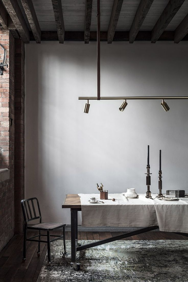 In this dramatic dining space original features are offset by a scheme defined by mixed metals, linen & leather.