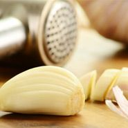 Vitamin E and aged garlic extract are effective at preventing cholesterol oxidation.