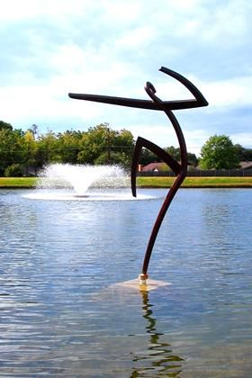 Haiku Dancer by Jerry Daniel.   This graceful piece virtually dances on the lake's surface, celebrating life. The 9-foot tall welded steel plate sculpture employs negative space to convey the artist's vision. North Richland Hills, Texas