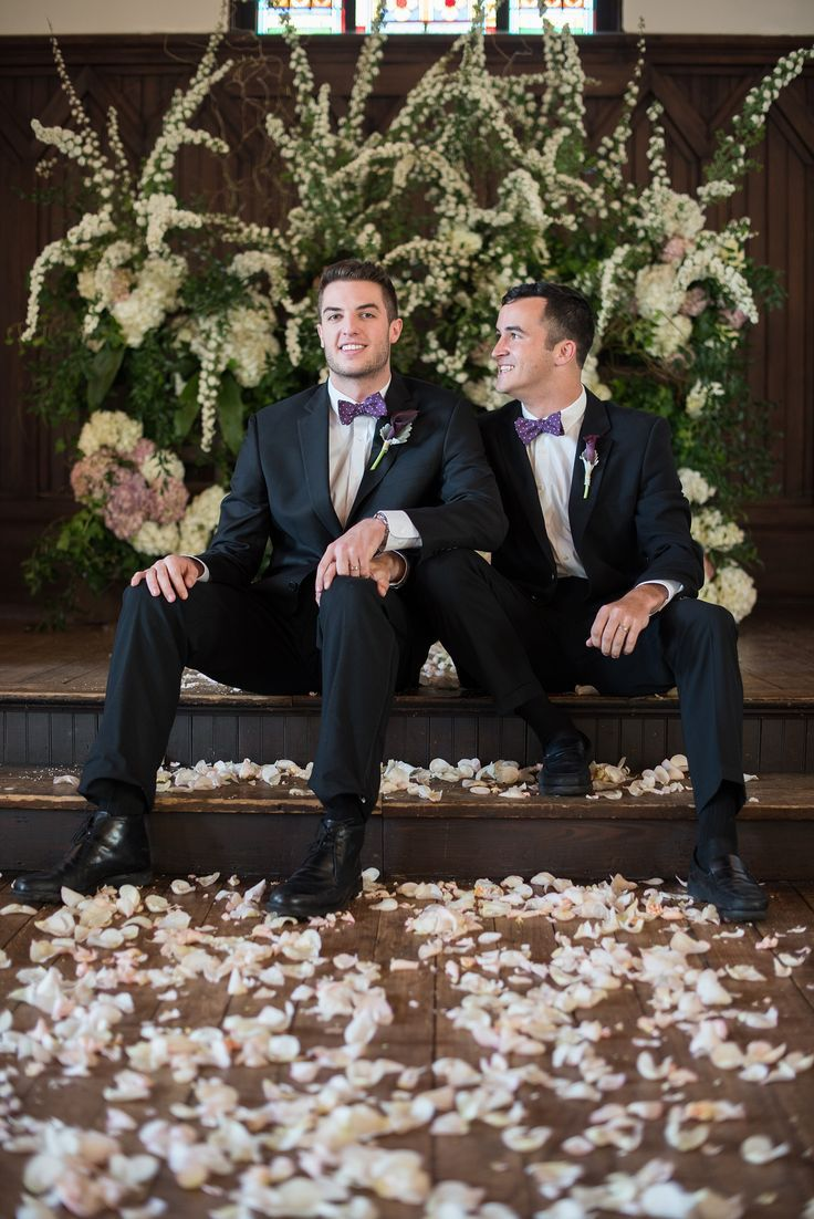 Purple, gold, black and white masculine details for a historic venue with a modern twist for a gay wedding in Raleigh. Photos by Mikkel Paige Photography.