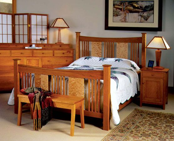 "The Joinery's ""Sorenson Reverse Deluxe Bed"" in cherry with quilted maple panels shown with Dunning nightstand and Grider dresser."