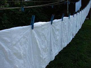 cloth diapers, being dried by our solar, wind generated clothes dryer