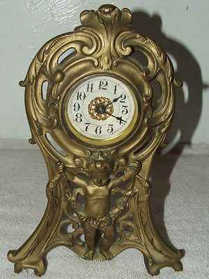 cherub cast clock vintage jpg 1152x768