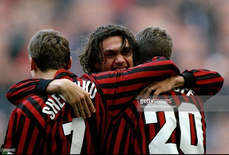 Andrei Schevchenko, Paolo Maldini and Oliver Bierhoff of AC Milan celebrate during the Italian Serie A match against Torino played at the San Siro in Milan, Italy. The game finished in a 2-0 win for Milan. Mandatory Credit: Claudio Villa /Allsport