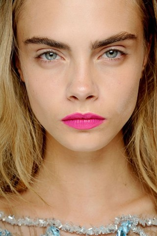 Giles  Bright pink lips stood out in an otherwise pared-back beauty look, whilst the matte texture contrasted with the dewiness of the skin to striking effect.