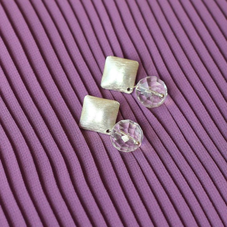 My favourite studs - chunky and delicate at the same time. Clear quartz faceted gemstones sparkle beautifully when the light hits them. Fine silver brushed studs are modern and elegant.