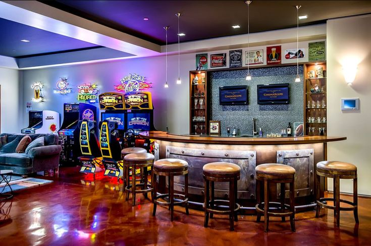 This cave meets all the check boxes for a classic fun cave. A bar with tvs, arcade games and a comfortable man couch.